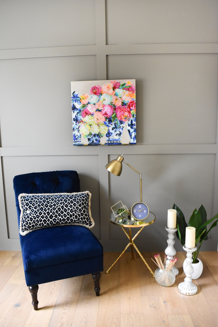 floral painting in blue and white ginger jars with neutral background.