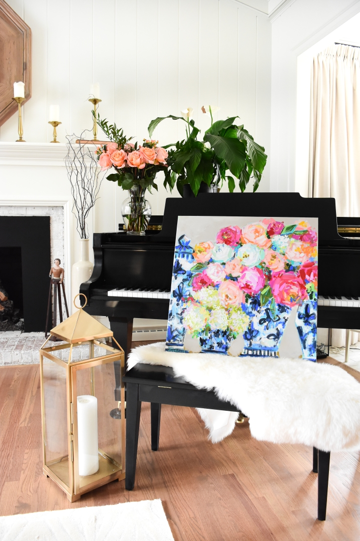 floral painting with blue and white ginger jars on piano with gold lantern